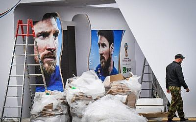 A man passes in front of commercial banners displaying Argentina's player Lionel Messi at Luzhniki stadium in Moscow on June 10, 2018, ahead of the Russia 2018 World Cup. (AFP PHOTO / Mladen ANTONOV)