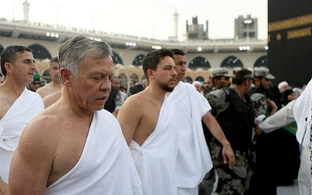In this handout picture released on June 10, 2018, by the Jordanian Royal Palace, shows King Abdullah II, left, and his son Crown Prince Hussein bin Abdullah performing the off season pilgrimage of Umra in the holy city of Mecca. (AFP/Jordanian Royal Palace / Yousef ALLAN)