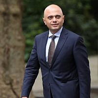 Britain's Home Secretary Sajid Javid walks along Downing Street in central London on June 12, 2018. (AFP/Daniel Leal-Olivas)