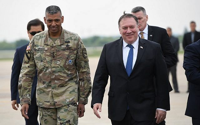 US Secretary of State Mike Pompeo, right, walks with US General Vincent K. Brooks commander of United States Forces Korea, upon his arrival at Osan Air Base in Pyeongtaek on June 13, 2018. (Jung Yeon-je/AFP)
