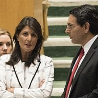 US Ambassador to the United Nations Nikki Haley talks with Israels Ambassador to the UN Danny Danon before a vote in the General Assembly, June 13, 2018 in New York. (AFP Photo/Don Emmert)