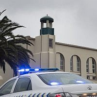 A police vehicle stands in front of the mosque following a stabbing attack that left two worshipers dead and the attacker shot by the police on June 14, 2018 in Malmesbury, north of Cape Town (AFP PHOTO / RODGER BOSCH)