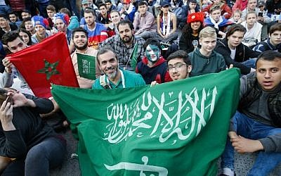 Supporters of Saudi Arabia's national football team pose as they watch the Russia 2018 World Cup Group A football match between Russia and Saudi Arabia in the fan zone near the main building of the Moscow State University in Moscow on June 14, 2018. (AFP Photo/Maxim Zmeyev)