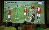 Saudi football fans watch the Russia 2018 World Cup Group A football match between Russia and Saudi Arabia at a fan tent in the capital Riyadh on June 14, 2018. (AFP/Fayez Nureldine)