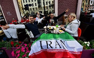Iran supporters pose for picture in a restaurant in St. Petersburg on June 14, 2018, on the eve of the Russia 2018 World Cup football match between Morocco and Iran. (AFP/Giuseppe Cacace)