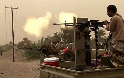 This image grab taken from a AFPTV video shows Yemeni pro-government forces firing a heavy machine gun at the south of Hodeida airport, in Yemen's Hodeida province, on June 15, 2018. (AFP Photo/AFPTV)