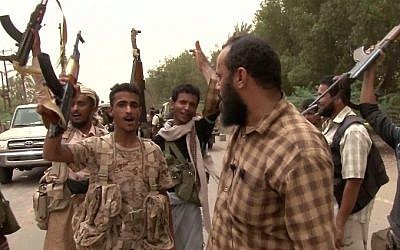 This image grab taken from a AFPTV video shows Yemeni pro-government forces gathering at the south of Hodeida airport, in Yemen's Hodeida province, on June 15, 2018. (AFP Photo/AFPTV)