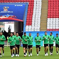 Players from Australia's national soccer team attend a training session at the Kazan Arena on June 15, 2018, in Kazan, Russia, on the eve of the team's opening match against France. (AFP Photo/Saeed Khan)