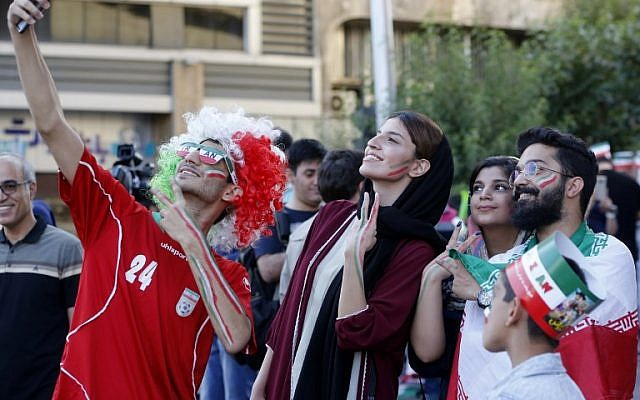 Iranians pose for a selfie before watching the World Cup Group B soccer match between Morocco and Iran at Azadi cinema in Tehran on June 15, 2018. (AFP/Atta Kenare)