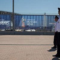 Security officers patrol outside the Volgograd Arena in Volgograd on June 16, 2018, ahead of the Russia 2018 World Cup Group G football match between Tunisia and England. (AFP PHOTO / NICOLAS ASFOURI)