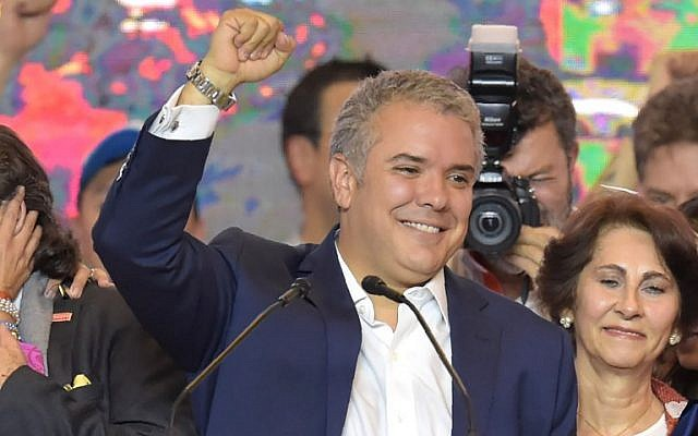 Newly elected Colombian president Ivan Duque celebrates with supporters in Bogota, after winning the presidential runoff election on June 17, 2018. (AFP/ Raul Arboleda)