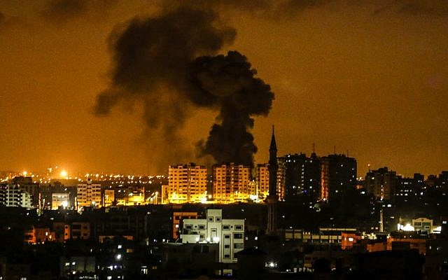 An explosion is seen in Gaza City after an airstrike by Israel on June 18, 2018. (AFP/ MAHMUD HAMS)