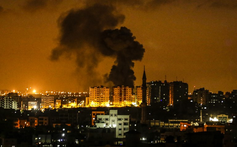 An explosion is seen in Gaza City after an airstrike by Israel