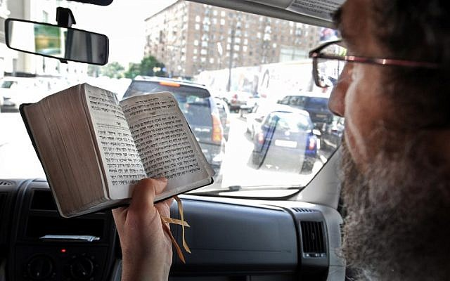 In this file photo taken on June 16, 2009 Russian Rabbi Boroukh Kleinberg reads from the Torah inside his Mitzvah Bus in Moscow. (AFP Photo/Alexander Nemenov)