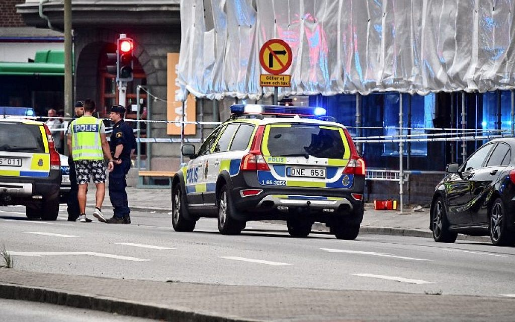 Illustrative: Police cordon off an area after four people were shot and injured on an open street in central Malmo, in southern Sweden, on June 18, 2018. (AFP PHOTO / TT News Agency / Johan NILSSON)
