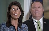 US Secretary of State Mike Pompeo looks on as US Ambassador to the United Nation Nikki Haley speaks at the US Department of State in Washington DC on June 19, 2018.(AFP Photo/Andrew Caballero-Reynolds)