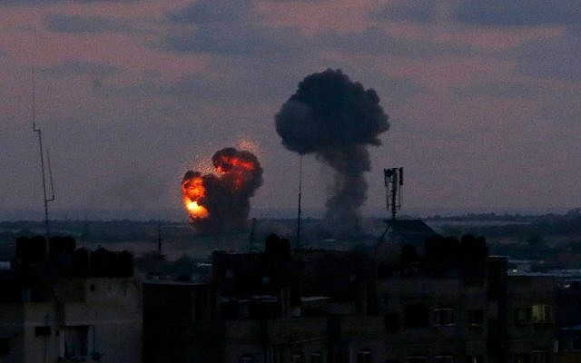 Illustrative: An explosion is seen from the city of Rafah in the southern Gaza Strip after an airstrike by Israeli forces in response to dozens of rocket attacks by Palestinian terrorist groups from the coastal enclave on June 20, 2018. (Said Khatib/AFP)