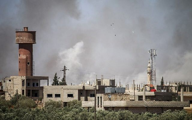 Illustrative: Smoke plumes rising from regime bombardment on the town of Al-Mulayhah al-Sharqiyah in the eastern Daraa province countryside in southern Syria, June 21, 2018. (Mohamad ABAZEED/AFP)