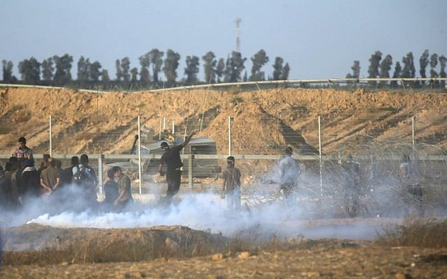 Illustrative. Palestinians clash with Israeli forces along the border between the Gaza Strip and Israel, east of Khan Younis in southern Gaza, on June 22, 2018. (AFP Photo/Said Khatib)