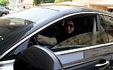 Daniah al-Ghalbi, a newly-licensed Saudi woman driver, sits in her car during a test-drive in the Red Sea resort of Jeddah on June 23, 2018, a day before the lifting of a ban on women driving in the conservative Arab kingdom. (AFP / Amer HILABI)