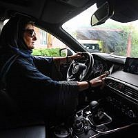 Hala Hussein Alireza, a newly-licensed Saudi motorist, drives a car in the Red Sea coastal city of Jeddah early on June 24, 2018. (AFP Photo/Amer Hilabi)