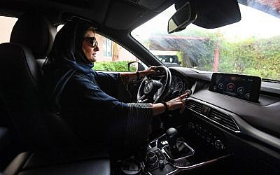 Hala Hussein Alireza, a newly-licensed Saudi motorist, drives a car in the Red Sea coastal city of Jeddah early on June 24, 2018. (AFP Photo/Amer Hilabi)