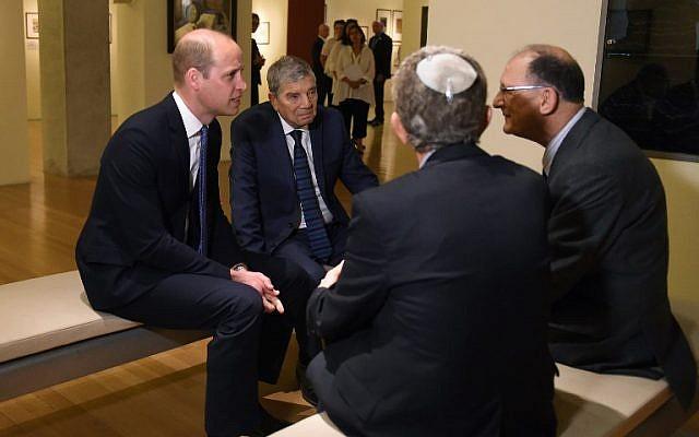 Britain's Prince William (L) and chairman of Yad Vashem Avner Shalev (2nd L) meet Kindertransport survivors during a visit at the Yad Vashem Holocaust memorial in Jerusalem on June 26, 2018. (AFP Photo/Pool/Debbie Hill)