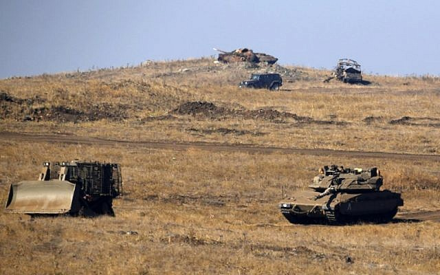 Israeli armored vehicles are seen during a military exercise in the Golan Heights near the Syrian border