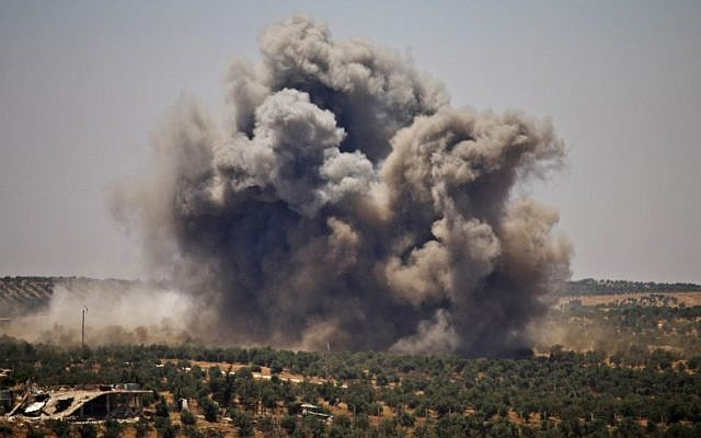 Smoke rises above opposition held areas of Daraa during airstrikes by Syrian regime forces on June 26, 2018. (Mohamad ABAZEED/AFP)
