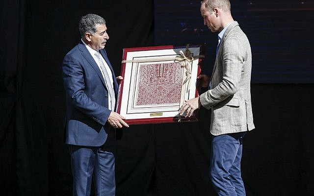 Britain's Prince William receives a gift from Musa Hadid, the mayor of Ramallah, at a reception during his visit to the West Bank city's municipality on June 27, 2018. (AFP PHOTO / POOL / ABBAS MOMANI)