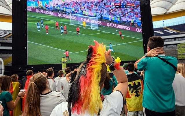 Supporters of the German national football team react as they attend a public viewing event at the Commerzbank Arena stadium in Frankfurt am Main, western Germany, to watch the Russia 2018 World Cup Group F football match between South Korea and Germany on June 27, 2018. (AFP PHOTO / dpa / Andreas Arnold)