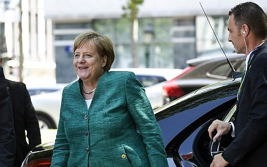 Embattled Merkel draws up new measures to tackle migration