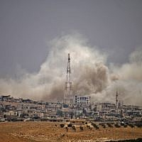 Smoke rises above opposition held areas of the city of Daraa during airstrikes by Syrian regime forces on June 28, 2018. (AFP PHOTO / Mohamad ABAZEED)