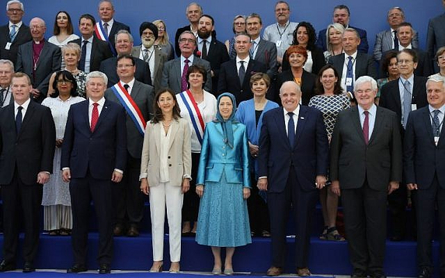 "(L-R, front row) Former Canadian foreign minister John Baird, Canadian retired politician Stephen Joseph, Colombian-French politician and former senator Ingrid Betancourt, leader of the People's Mujahedin of Iran Maryam Rajavi, former US mayor of New York City and attorney to US President Donald Trump Rudolph Giuliani, former US Speaker of the House Newt Gingrich, US author and Chairman of the Center for Equal Opportunity Linda Chavez (2nd row, 3rd R), and Italy's former Foreign Affairs Minister Giulio Terzi di Sant'Agata (2nd row, R) pose for a picture during the meeting ""Free Iran 2018 – the Alternative"", organized by the People's Mujahedin of Iran in Villepinte, near Paris on June 30, 2018. (AFP Photo/Zakaria Abdelkafi)"
