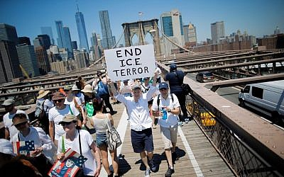Demonstrators cross the Brooklyn Bridge during a march against the separation of families caught illegally crossing the US-Mexico border, on June 30, 2018 in New York. (AFP Photo/Eduardo Munoz Alvarez)