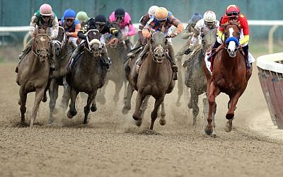 Justify #1, right, ridden by jockey Mike Smith leads the field around the 4th turn during the 150th running of the Belmont Stakes at Belmont Park in Elmont, New York, on June 9, 2018. (Jim McIsaac/Getty Images/AFP)