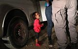 A two-year-old Honduran asylum seeker cries as her mother is searched and detained near the US-Mexico border on June 12, 2018 in McAllen, Texas (John Moore/Getty Images/AFP)