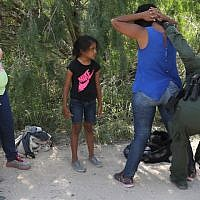 Central American migrants are taken into custody by US Border Patrol agents on June 12, 2018, near McAllen, Texas. (John Moore/Getty Images/AFP)