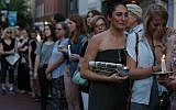 People line up on both sides of Main St. during a candlelight vigil to honor the 5 people were shot and killed at the Capital Gazette newpaper  on June 29, 2018 in Annapolis, Maryland. (Mark Wilson/Getty Images/AFP)
