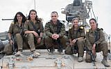 Head of the IDF Armored Corps Brig. Gen. Guy Hasson, center, poses on a tank with the army's first female tank commanders, who graduated their course on June 28, 2018. (Israel Defense Forces)