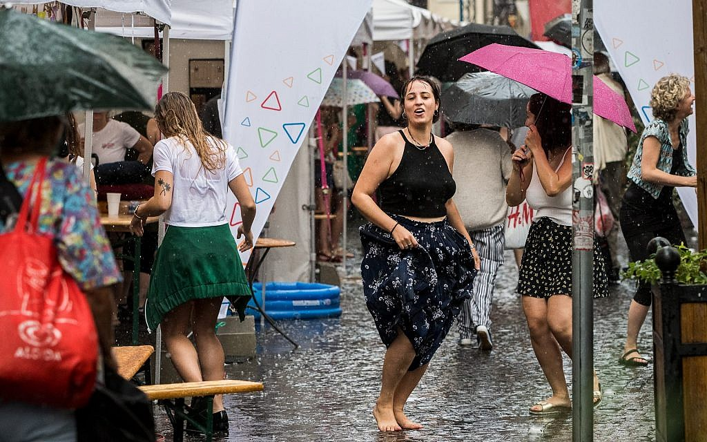 Young people dance in the rain at the Judafest street festival in Budapest, June 10, 2018.(Marton Monus/ Balint House JCC)