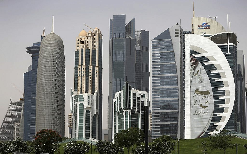 In this May 5, 2018 photo, a giant image of the Emir of Qatar Sheikh Tamim bin Hamad Al Thani, adorns a tower in Doha, Qatar. (AP Photo/Kamran Jebreili)