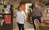 """In this image released by ABC, Roseanne Barr, left, and John Goodman appear in a scene from """"Roseanne."""" (Adam Rose/ABC via AP)"""