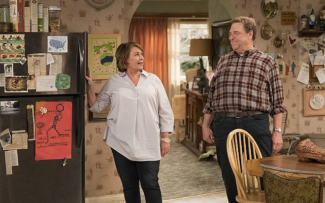"In this image released by ABC, Roseanne Barr, left, and John Goodman appear in a scene from ""Roseanne."" (Adam Rose/ABC via AP)"