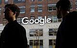 People walk by Google offices in New York, December 4, 2017. (AP/Mark Lennihan)