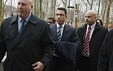 In this December 23, 2014 file photo, then-Rep. Michael Grimm, center, enters Brooklyn federal court before pleading guilty to a federal tax evasion charge in New York. Grimm doesn't want to talk about his time in prison. (AP Photo/John Minchillo, File)