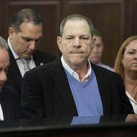 In this May 25, 2018 file photo, Harvey Weinstein, center, listens during a court proceeding in New York during his arraignment on rape and other charges. (Steven Hirsch/New York Post via AP, Pool)
