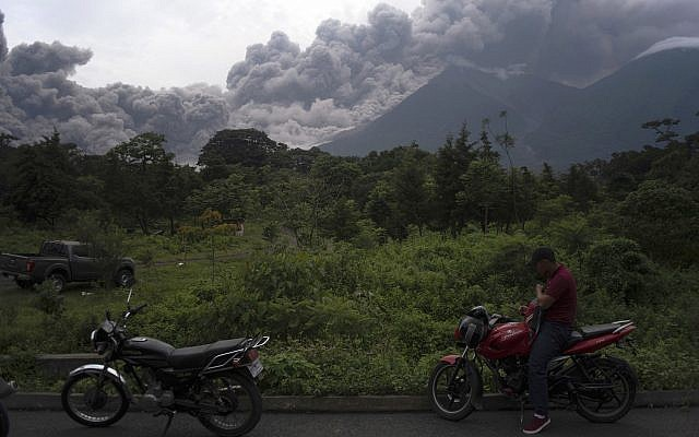Volcan de Fuego, or Volcano of Fire, blows outs a thick cloud of ash, as seen from Alotenango, Guatemala, June 3, 2018. (Santiago Billy/AP)