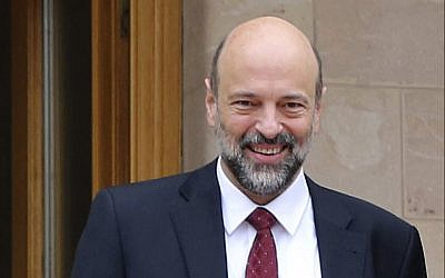 This January 15, 2017 file photo shows then-newly appointed Jordanian education minister Omar Razzaz, following a meeting at the Royal Palace in Amman, Jordan. (Khalil Mazraawi, Pool via AP, File)