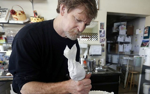 In this March 10, 2014, photo, Masterpiece Cakeshop owner Jack Phillips decorates a cake inside his store in Lakewood, Colo. (AP Photo/Brennan Linsley)